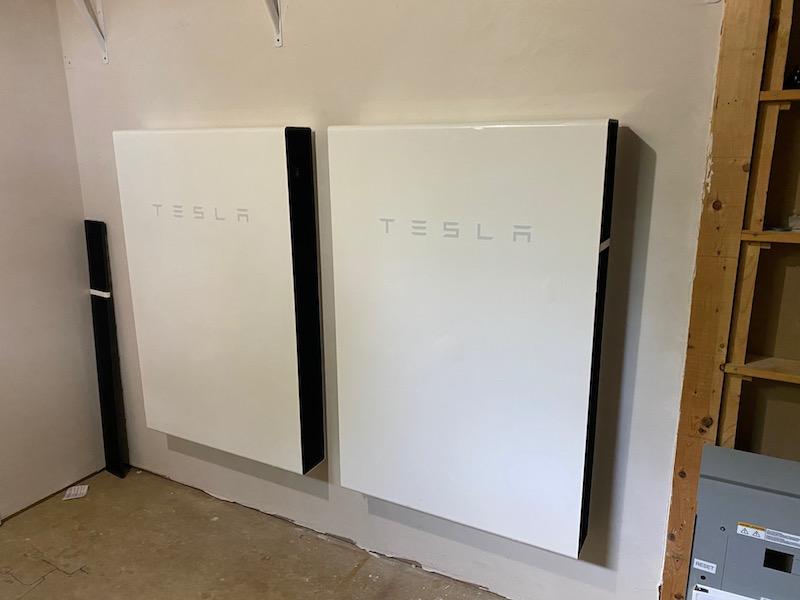 Two Tesla Powerwall solar batteries wall mount install